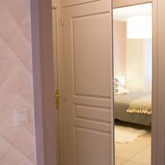 Aménagement et décoration d'un appartement: Couloir et hall d'entrée de style  par DLS Création