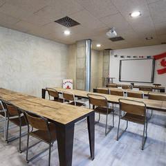 REFORMA DE CENTRO DE INGLÉS: Escuelas de estilo  de Novodeco