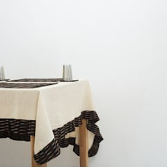 Table Edition: rustic Dining room by TUNI Interiors Pvt. Ltd.