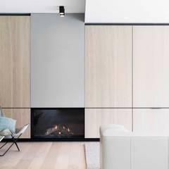 Project K: moderne Woonkamer door JUMA architects
