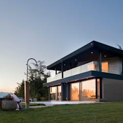 Villa in collina: Case in stile  di iarchitects