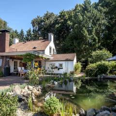 Renovatie en uitbreiding jaren 50-woning:  Huizen door Bob Romijnders Architectuur & Interieur