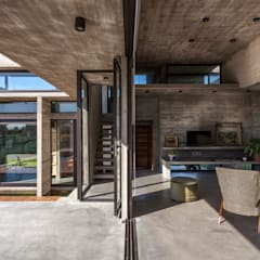 Casa Berazategui: Garajes de estilo  por Besonías Almeida arquitectos,Moderno Hormigón