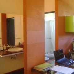 Baños de estilo  de Marcelo Manzán Arquitecto