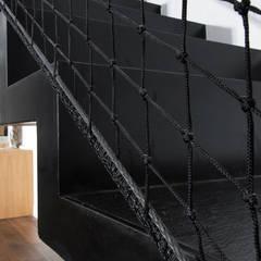 JUST'IN: Couloir et hall d'entrée de style  par Florence Gaudin architecte