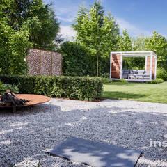 Kameralny ogród nowoczesny: styl , w kategorii Ogród zaprojektowany przez Studio architektury krajobrazu INSPIRACJE,