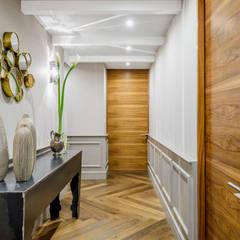 Pasillos y vestíbulos de estilo  por NIVEL TRES ARQUITECTURA