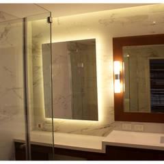 Reforma integral de piso sobre Av. Libertador: Baños de estilo ecléctico por KorteSa arquitectura