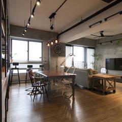 Salas de jantar  por 珞石設計 LoqStudio