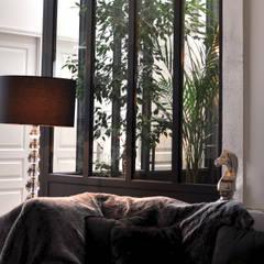 PROJET L: Réhabilitation de greniers en appartement familial: Jardin d'hiver de style  par PLAST Architectes