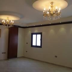 Mr. Hamdy Appartment:  غرفة المعيشة تنفيذ Etihad Constructio & Decor