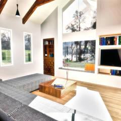 Living: Livings de estilo  por NidoSur Arquitectos