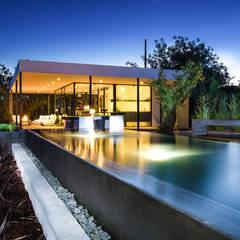Nomad Living: Casas  por studioarte,Moderno