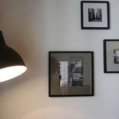 Aménagement D'un appartement LYON: Murs de style  par AL Intérieurs