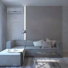 Monochromatyczna aranżacja wnętrza w kolorze szarym : styl , w kategorii Salon zaprojektowany przez living box