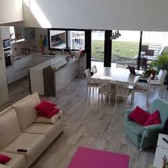 Casa Pellegrini: Livings de estilo  por Articular Arquitectura