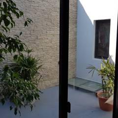 Casa Pellegrini: Jardines de invierno de estilo  por Articular Arquitectura