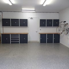 Resin Floor, Metal Cabinets and Bike Storage Galore in this lovely garage makeover in Cambridge: modern Garage/shed by Garageflex