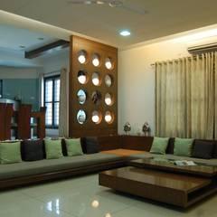 Residence : modern Living room by AM Associates