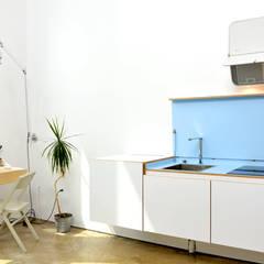 Mini Craven:  Kitchen by Linebox Studio
