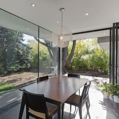 The Hambly House: modern Dining room by dpai architecture inc