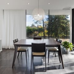 The Hambly House:  Dining room by dpai architecture inc