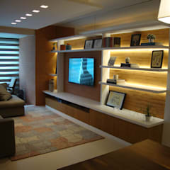 Apartamento Coqueiros: Salas de estar  por Geraldo Brognoli Ludwich Arquitetura