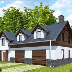IMU0001: styl rustykalne, w kategorii Domy zaprojektowany przez PROMO Pracownia Projektowa