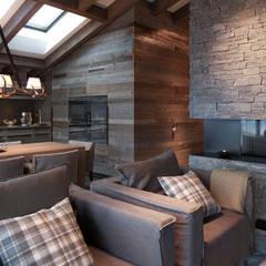Ferienwohnung Laax: landhausstil Wohnzimmer von Go Interiors GmbH