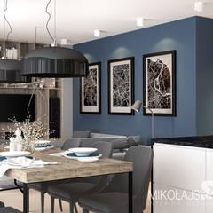 Salon z aneksem kuchennym i jadalnią: styl , w kategorii Jadalnia zaprojektowany przez MIKOŁAJSKAstudio