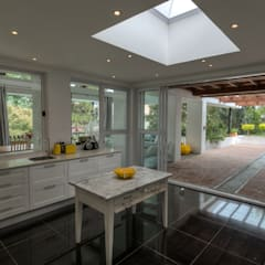 Alteration Close:  Kitchen by Architects Of Justice,