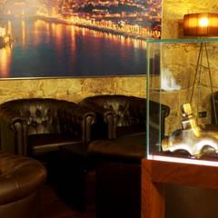 Wine cellar by Área77 - arquitectura, engenharia e design, lda