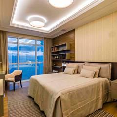 Apartamento Millenium Pallace: Quartos  por TRÍADE ARQUITETURA
