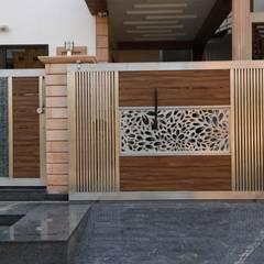 Modern Residence:  Houses by RAVI - NUPUR ARCHITECTS,Modern Aluminium/Zinc