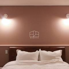 이국적인 느낌의 인테리어 이사후_35py: 홍예디자인의  침실