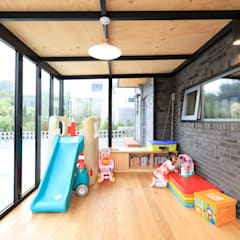 벽돌의 귀환! 대전 탑립동주택: 주택설계전문 디자인그룹 홈스타일토토의  베란다,모던 우드 우드 그레인
