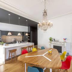 Un Haussmannien décoré: Salle à manger de style  par Dominique Marcon, Classique
