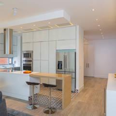 Apto Cr 2 - Cll 69: Cocinas de estilo  por Bloque B Arquitectos