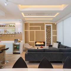 Apto Cr 2 - Cll 69: Salas de estilo  por Bloque B Arquitectos