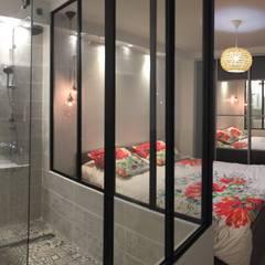 Suite parentale: Salle de bains de style  par Mint Design
