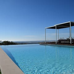 Breathtaking infinity pool in Estoi, Algarve:  Pool by Engel & Voelkers Vilamoura