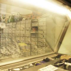 美式單車品牌 . 服飾店Nabiis :  商業空間 by 光島室內設計, 簡約風