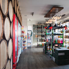 : Oficinas y tiendas de estilo  por TAMEN arquitectura