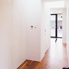 Extension & House Renovation SW18 - London:  Corridor & hallway by Diamond Constructions Ltd, Modern