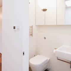 Extension & House Renovation SW18 - London:  Bathroom by Diamond Constructions Ltd