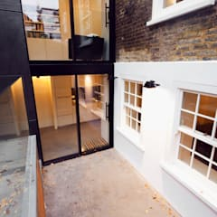 Extension & House Renovation SW18 - London:  Houses by Diamond Constructions Ltd,