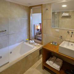 Suites&Aparts Huenu.: Hoteles de estilo  por INTEGRAR DISEÑO