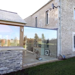 Conservatory by IQ Glass UK,