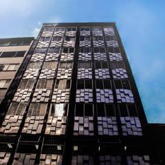 FACHADA EDIFICIO GUACAICA: Edificios de oficinas de estilo  por santiago dussan architecture & Interior design