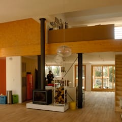 entrée dans le loft : Cuisine de style  par Solari et associés